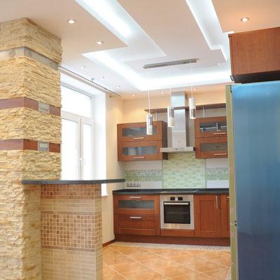 Фото 2 - барная стойка отделяет кухню от гостиной
