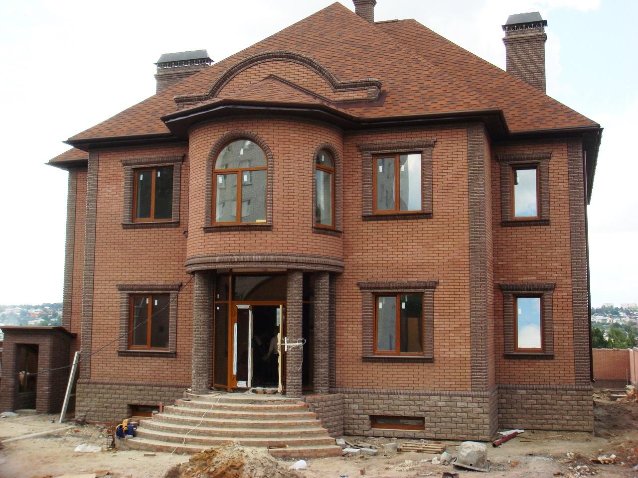 Двухэтажные дома из кирпича фото